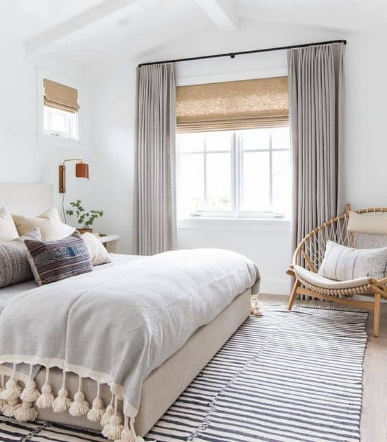 how to hang window treatments to make windows and rooms look bigger